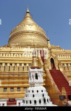 Shwezigon Pagoda is The one of the most beautiful pagodas in Bagan. The gold-painted main structure of the Shwe - Stock Photo