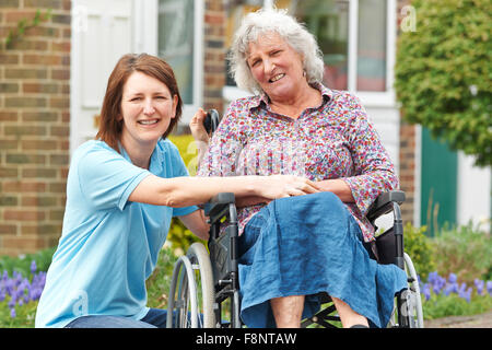 Carer With Senior Woman In Wheelchair - Stock Photo
