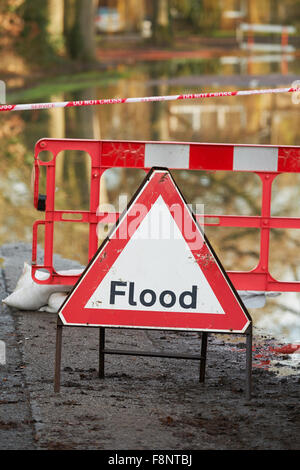 Warning Sign On Flooded Road - Stock Photo