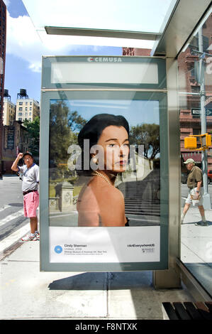 A Cindy Sherman fine art photograph is reproduced on a bus shelter advertising panel in New York  City as part of - Stock Photo