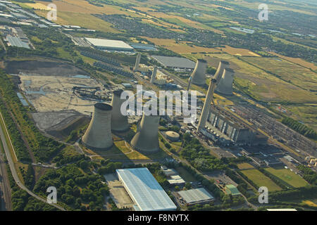 An aerial view of Didcot coal fired power station showing the cooling towers and huge chimney as well as the turbine hall.