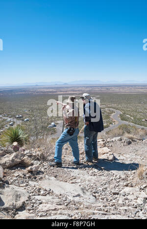 Two hikers at the Oliver Lee State Park pause to look out over the huge expanse of desert in southern New Mexico. - Stock Photo