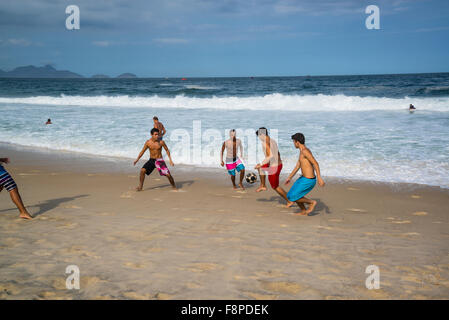 Copacabana Beach, Playing football, Rio de Janeiro, Brazil - Stock Photo