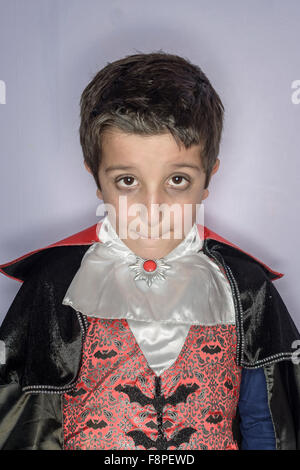 Portrait of boy,8,dressed in Halloween costume - Stock Photo