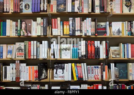 Books on shelves in bookstore,UK