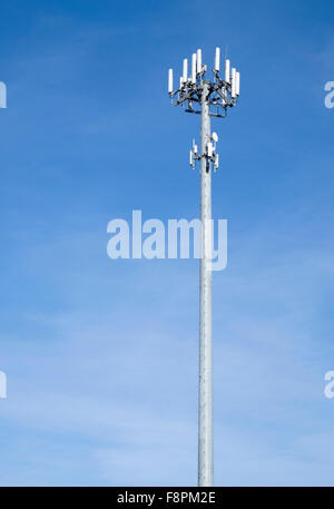 Cell phone tower mast pole with multiple antennas - Stock Photo