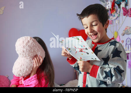 Child reading thank you card from Santa - Stock Photo