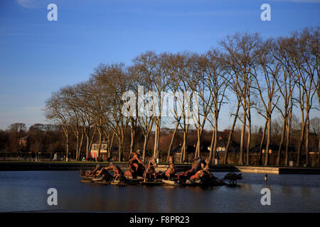 Late afternoon sun strikes the Apollo Fountain in the grounds of the Palace of Versailles, on the outskirts of Paris, - Stock Photo