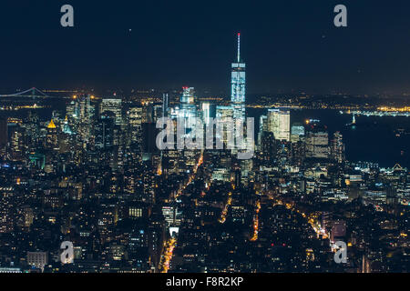 New York City - September 26: Manhattan night view from the Empire State Building. Statue of Liberty to the Brooklyn - Stock Photo