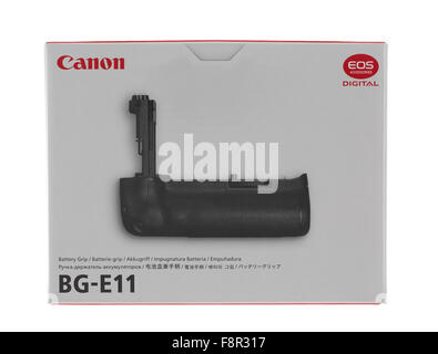 Canon BG-E11 Battery Grip for a 5D Mark III DSLR on a White background - Stock Photo