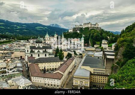 View of Salzburg Cathedral and hohensalzburg castle in Altstadt, Salzburg, Austria - Stock Photo