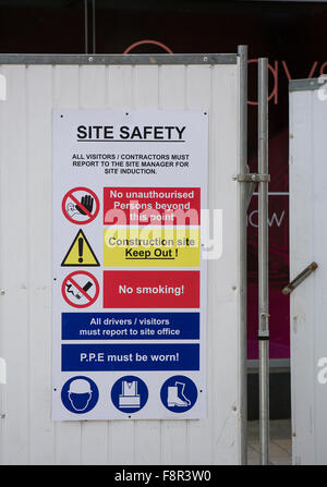 Construction Site,  entrance to a construction site with health and safety notices - Stock Photo