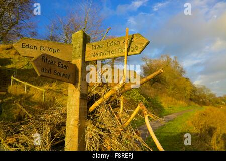 Aftermath of Carlisle Floods. December 2015. Foot path sign showing flotsam illustrating height of flooded River - Stock Photo