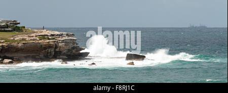 Crashing Waves against rocks,  Bondi Beach, New South Wales, Australia - Stock Photo