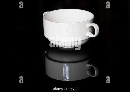 Empty white porcelain sauce-boat - Stock Photo