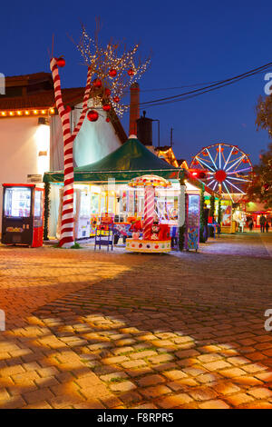 Christmas fair and market in the neighbourhood of Gazi in the old gasworks of Athens, Greece - Stock Photo