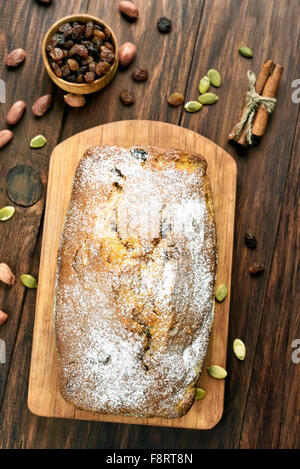 Pumpkin loaf on wooden cutting board, top view - Stock Photo