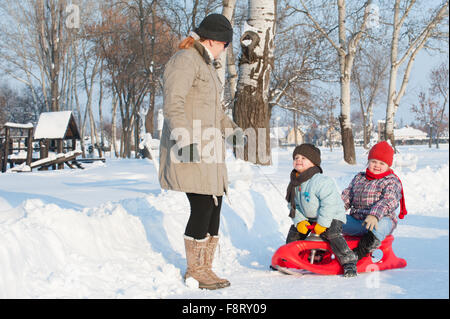 children and families in the snow - Stock Photo