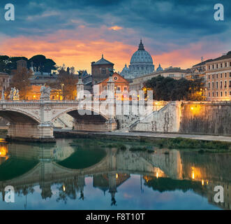 Rome. View of Vittorio Emanuele Bridge and the St. Peter's cathedral in Rome, Italy during sunset. - Stock Photo