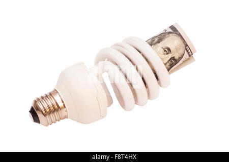 Energy saver bulb with 100 dollar bills on white background - Stock Photo