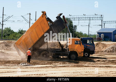 Two trucks with raised bodies, construction sand paintings - Stock Photo