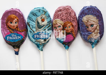 M&S 4 chocolate lollies lollipops foil wrapped with different characters from Disney Frozen set on white background - Stock Photo