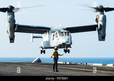 An MV-22 Osprey from the 'Greyhawks' of Marine Medium-Lift Tiltrotor Squadron (VMM) 161 (Reinforced) takes off from  the flight deck of the Wasp-class amphibious assault ship USS Essex (LHD 2). The Bell Boeing V-22 Osprey is an American multi-mission, tiltrotor military aircraft with both a vertical takeoff and landing (VTOL), and short takeoff and landing (STOL) capability. Stock Photo
