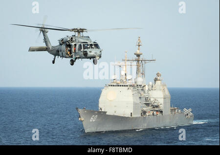 HH-60H Sea Hawk helicopter assigned to the Sea Knights of Helicopter Sea Combat Squadron (HSC) 22 passes the guided - Stock Photo