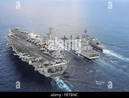 The aircraft carrier USS Theodore Roosevelt (CVN 71) and Japanese Maritime Self-defense Force Akizuki-class destroyer - Stock Photo