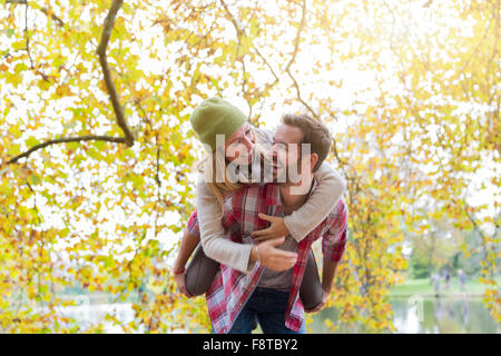 Young couple dating in forest - Stock Photo