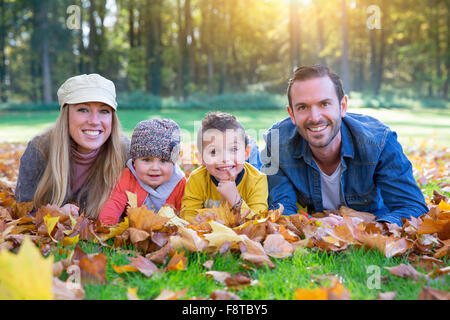 Portrait of a family lying down - Stock Photo