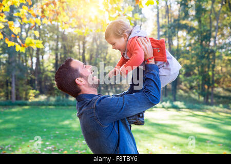 Dad playing with his daughter - Stock Photo
