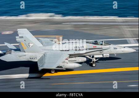 "F/A-18C Hornet, assigned to the ""Rampagers"" of Strike Fighter Squadron (VFA) 83, lands on the flight deck of aircraft - Stock Photo"