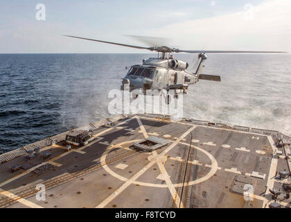 MH-60R Sea Hawk helicopter lands on the flight deck of guided-missile destroyer USS Bulkeley - Stock Photo