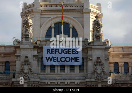 Madrid, Spain 11th December 2015: A 'Refugees Welcome' banner hangs above the entrance of the Palacio de Comunicaciones - Stock Photo