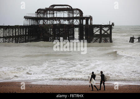 Brighton old west pier with flying starlings. UK, England. - Stock Photo