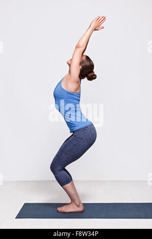 Woman doing ashtanga vinyasa yoga asana Utkatasana - Stock Photo