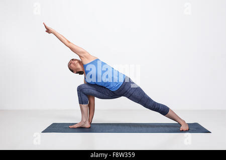 Woman doing Ashtanga Vinyasa Yoga asana - Stock Photo