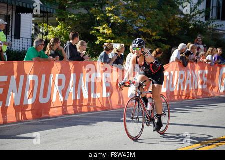 Bicyclists on bikes racing in the Ironman Triathlon - Stock Photo