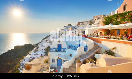 Afternoon view at Oia Town (northern part of the Santorini) with sun in the background, Santorini Island, Cyclades, - Stock Photo