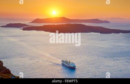 Landscape view with cruise ship on the Aegean Sea and Nea Kameni Island taken from Thira ( Fira), Santorini Island, - Stock Photo