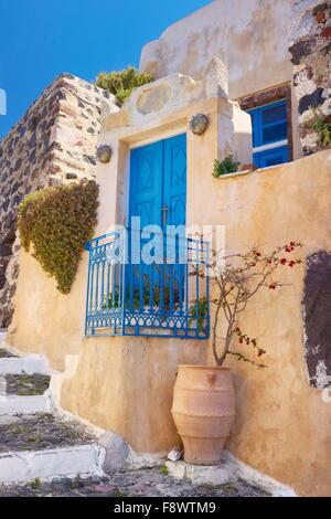 Street scene with a greek vase and blue door in Pyrgos, Santorini Island, Cyclades Islands, Greece - Stock Photo