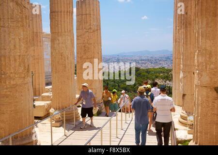 Athens - Acropolis, tourists in the passage through the Propylaea, Greece - Stock Photo