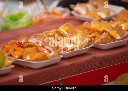Thai Traditional Snack and Dessert, Thai Crispy Pancake or Thai Crepes Filled with Sweet Coconut Cream (Kanom Buang) - Stock Photo
