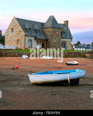 Ancient house and boats on a mooring - beautiful scenery at sunset - Stock Photo
