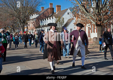 Williamsburg, Virginia - Costumed living history reenactors walk Duke of Gloucester Street in Colonial Williamsburg. - Stock Photo