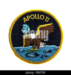 Apollo 11 Mission Badge from the first Moon landing in 1969 on a White Background - Stock Photo