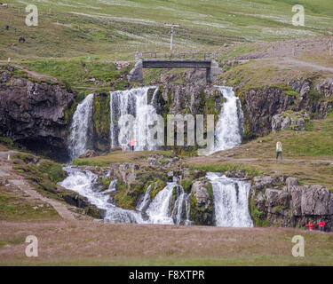 Snaefellsnes Peninsula, Iceland. 30th July, 2015. Tourists observe a series of waterfalls on the Snaefellsnes peninsula - Stock Photo