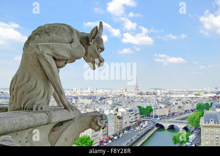 Gargoyle Statue in Notre Dame Cathedral and Paris aerial cityscape with Eiffel Tower on background. Paris, France - Stock Photo