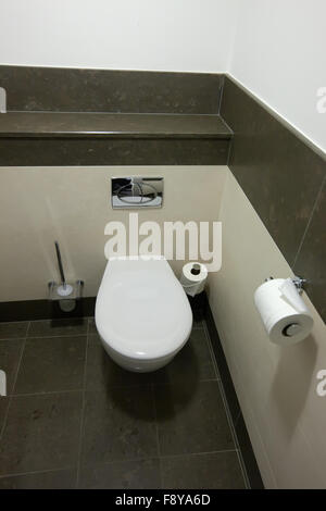 White toilet bowl in bathroom - Stock Photo